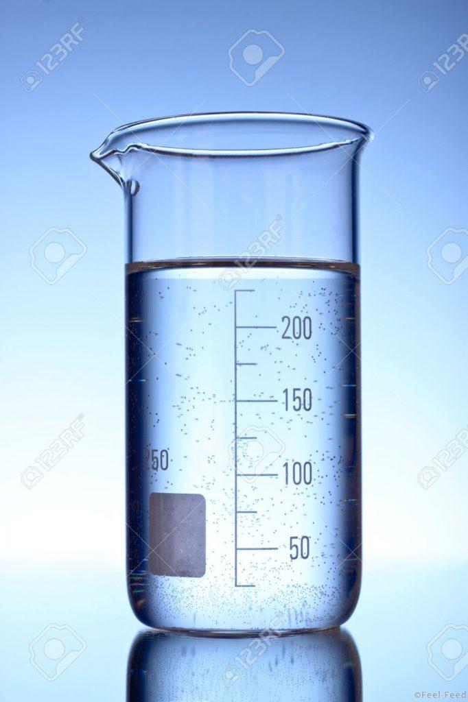 9322511-graduated-beaker-on-blue-background-stock-photo
