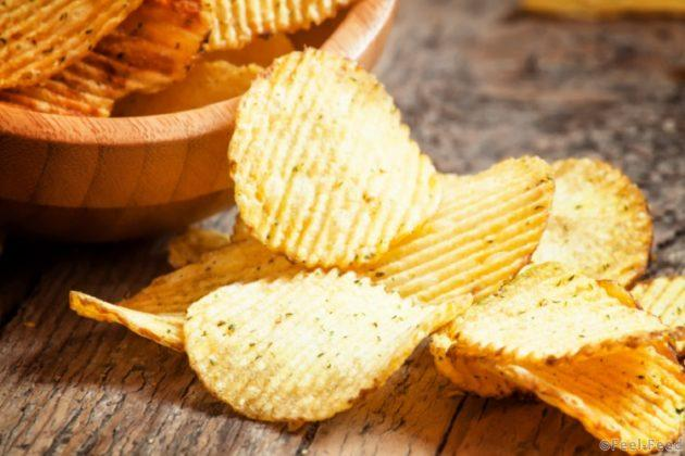 Rippled potato chips in a  bowl, selective focus