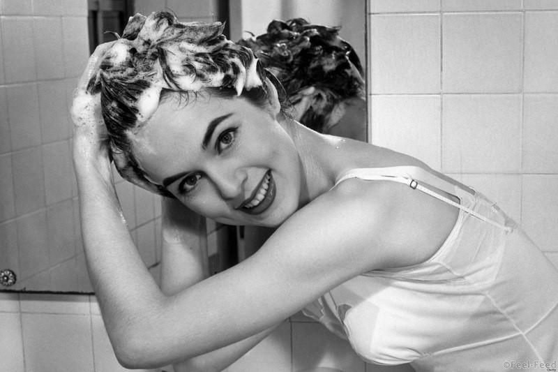 UNITED STATES - CIRCA 1950s: Woman washing hair in bathroom sink. (Photo by George Marks/Retrofile/Getty Images)